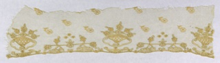 Fragment of needlework on net showing baskets of flowers resting on scrolling brackets. Ground dotted with flower sprigs.