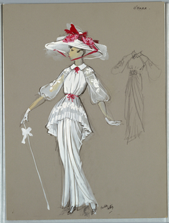 Vertical Rectangle. Woman in long white dress, full sleeves, white hat, red accents, cane in right hand.
