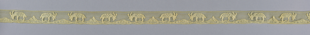 Narrow lace band with a pattern of two confronted antelope-like animals. Machine made in imitation of Mechlin-style bobbin lace.