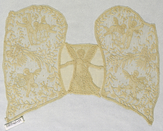 Lace ground with applied motifs in the design of cupids and floral sprays.