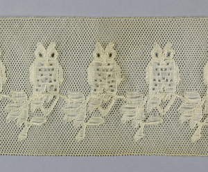 Mechlin style border with six point star ground (Point de Paris)  with a repeat of an owl sitting on a branch.