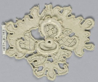 Fragment with a large blossom. Inner petals in a diamond diaper pattern. Outer petal deeply and irregularly scalloped.