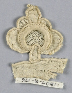 Fragment with a flower bud and a portion of the stem.