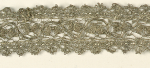 Band of silver lace made up of three pieces. Insertion is in the design of a serpentine stem with a scalloped border stitched to either side.