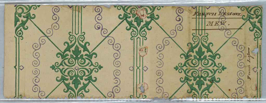 Full width of paper with diagonal squares composed of green lines, with large pseudo-anthemion motifs at points of intersection. Secondary of violet scrolls in vertical meander. Printed in green and violet on ungrounded paper. Formerly used as a book cover.
