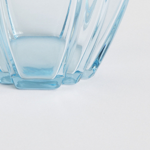 Truncated ovoid shaped vase with three-dimensional curved relief. Translucent blue.