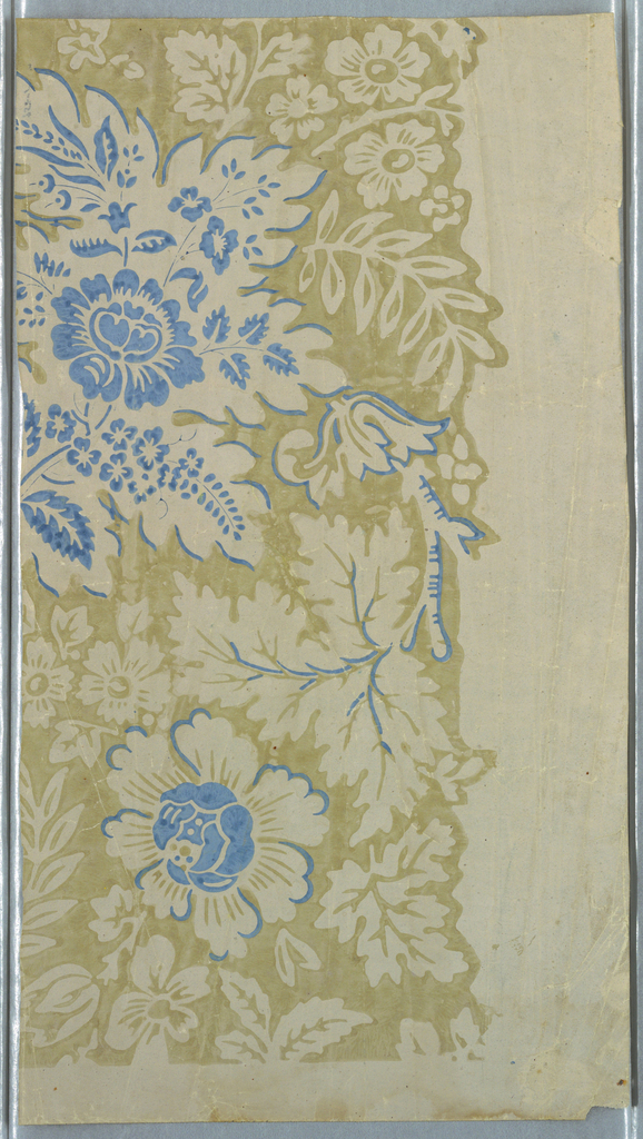 Against a glazed, light brown ground is printed a negative design of leaves, blossoms and leafy branches in the ground color of light beige. Details and a large floral cluster are printed in pale blue.