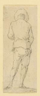 A standing man in a brimmed hat, viewed from behind.