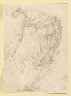 A man faces left, bending at the waist and holding a cloth.