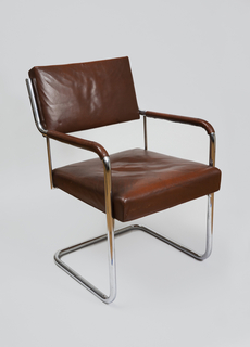 Cantilever chair with frame made of chromium-plated tubular steel. The seat and back are upholstered with leather, as are the armrests.