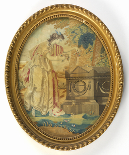 "Oval embroidered silk picture showing a classically draped female figure with wings on her head, strewing flowers on the tomb of Shakespeare. After ""Fame Adoring Shakespeare's Tomb,"" by Angelica Kaufmann. In a landscape with a grassy foreground, architectural element behind the tomb, trees overhead and sky with white clouds. Embroidered in colored silks except for the sky, wings, head, arms and feet, which are painted."