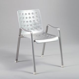 One-piece seat and back made of bent aluminum sheet perforated with 60 circular holes; legs and armrests of curved aluminum strips; white rubber feet.