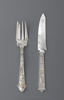 Fish fork engraved on both handle and prongs. On prongs: abstract and floral pattern; handle decorated with pagoda and trees in landscape; terminal with scalloped edge.
