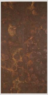 Oxidized flexible metal wallcovering, random circular pattern.