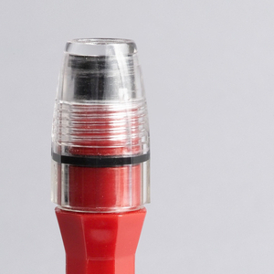 Red plastic faceted body in form of pen, with pen clip end.  Body fitted with clear faceted cylindrical threaded lens covering lamp; small circular magnet at opposite end; removable black rubber cap with clear plastic curved rod (Litebender attachment) fits over lens to make flashlight function in manner of fiber optics, showing narrow, bright, focused beam.