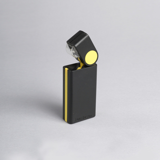 """Cigarette lighter""-like rectangular black body with yellow stripe, yellow disk at joint with pivoting rectangular head; small lamp contained in head."