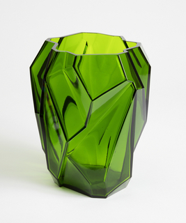 Tall angular dark green vase, asymmetrical form mimicking a natural rock, with a wide opening