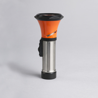 Cylindrical metal shaft with black on/off switch on side, conical orange and black plastic lamp housing (partially turns to rise and create focusing beam).