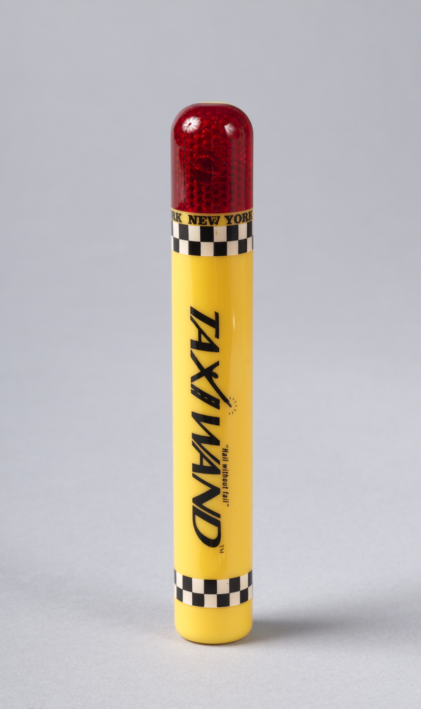 Yellow cylinder decorated with black and white checkered bands at each end; red LED light at one end.
