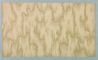 Paper is a moire effect and frosted. Ivory field with design frosted in ivory.