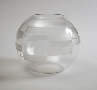 Circular blown glass deep bowl with medium wide opening, decorated with rectangles and dots that are asymmetrically placed