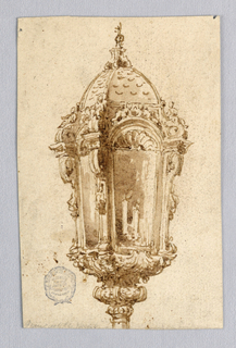 A domes lantern on a stand. Four sides with scrolling corbels. A hemisphere with shell above each pane of glass. Candles visible within.