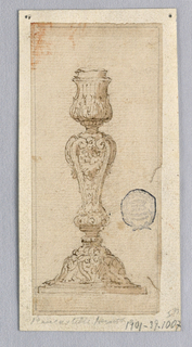 Vertical rectangle. Baluster form shaft with scrolls.