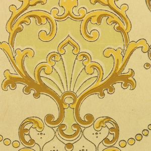 On cream-colored ground, repeating pattern of scrollwork in shades of creamy yellows, glossy-finish pale yellow and tans.