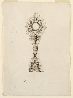 Vase shape on a plinth. Cross at top.