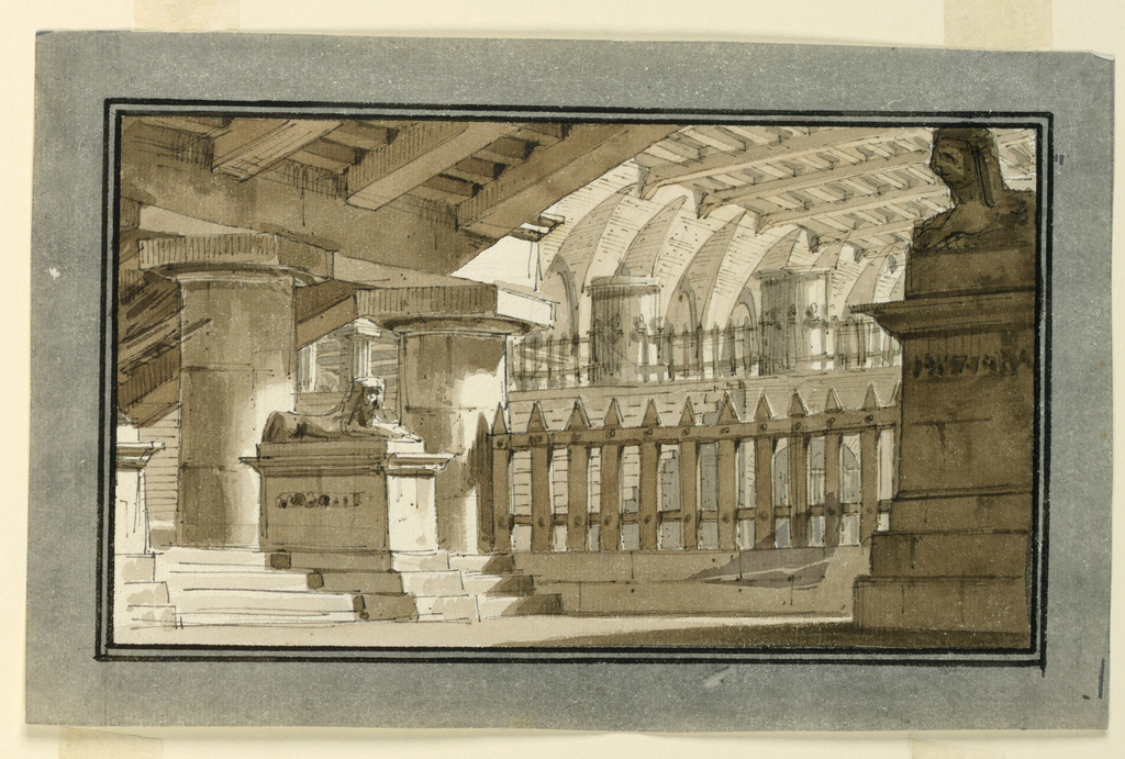 Horizontal rectangle. View of Egyptian hall with two sphinxes on pedestals at left and right, wooden bars at center.