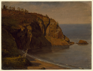 Coastal scene with a grass covered rocky promontory at left, a small cove in the foreground, and the ocean stretching out toward the horizon, at right.