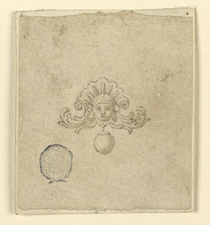 A female head is framed above by a fan and at the sides by rinceaux. Suspended below is a gem or pearl.