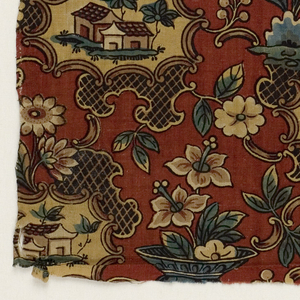Block printed cotton, red ground, small scale Chinoiserie design; uneven medallion frames with buildings center; vase with flowers.  Blue, brown, and red; yellow has faded out.