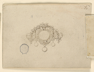 An escutcheon formed of floral volutes frames a round diamond. A garland of flowers draped above emerges from a vase form at center.  Three hanging pearls below.