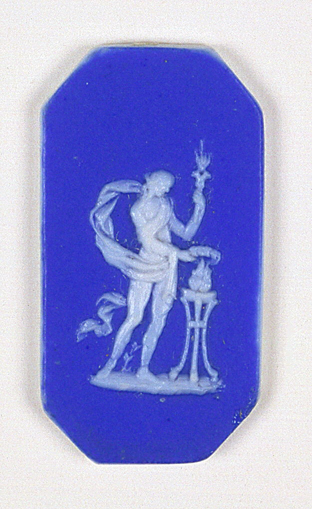 Four octagonal mounts in the style of Wedgewood Jasperware; each ornamented with a female figure, dancing; white on blue ground.