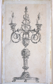 A vase shape stand upon a richly decorated baluster which rises from a base which is intended to be supported be four lion's feet.  From a calyx on top of the case emerge two acanthus scrolls carrying the sockets with low burning candles and a thyrsus.  Framing pencil lines.  Margin.