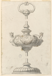 Vertical rectangle with oil lamp. Base is lobed. The stem is broken in two places. At center, two sirens with a festoon suspended between them. Ring at top composed of two volutes.