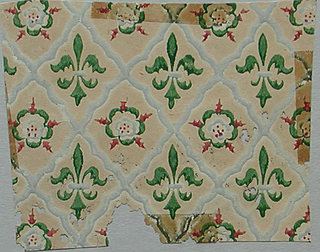 Diamond diaper design with fleur-de-lys and Tudor rose motifs alternating within the framework. Printed in green, gray and red on ungrounded tan paper.