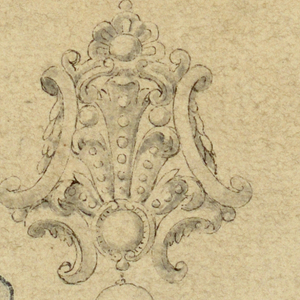 An escutcheon composed of volutes, topped with a palmette. A pearl drop at bottom.