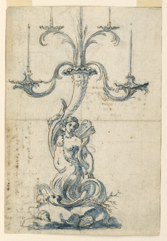 Rococo candlestick with mermaid with butterfly wings kneels upon a rock supporting a cornucopia from which five branches rise, four of which carry candle sockets.