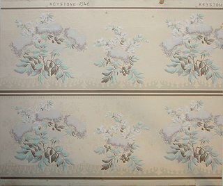 Floral bouquets, alternating large and small. Swags of passementerie or fringe below bouquet. Beading or fringe above. Printed two borders across. Printed in turquoise, pale blue, gray taupe and white mica on beige ground.