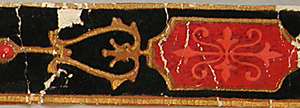Machine made, joined sheets of paper with touches of metallic gold ink. The design consists of a string of round and rectangular medallions containing modified fleur-de-lis. Linear curl decorations embellishes the string of medallions; printed in black flock with salmon, red, ochre, and gold.  H#45