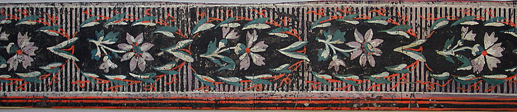 Horizontal rectangle. Border paper, with alternating motifs of spray of roses and leaf with berries. Across top and bottom edges, blue band with white serpentine line. Printed in white, pink, blue, green and brown, on black field.