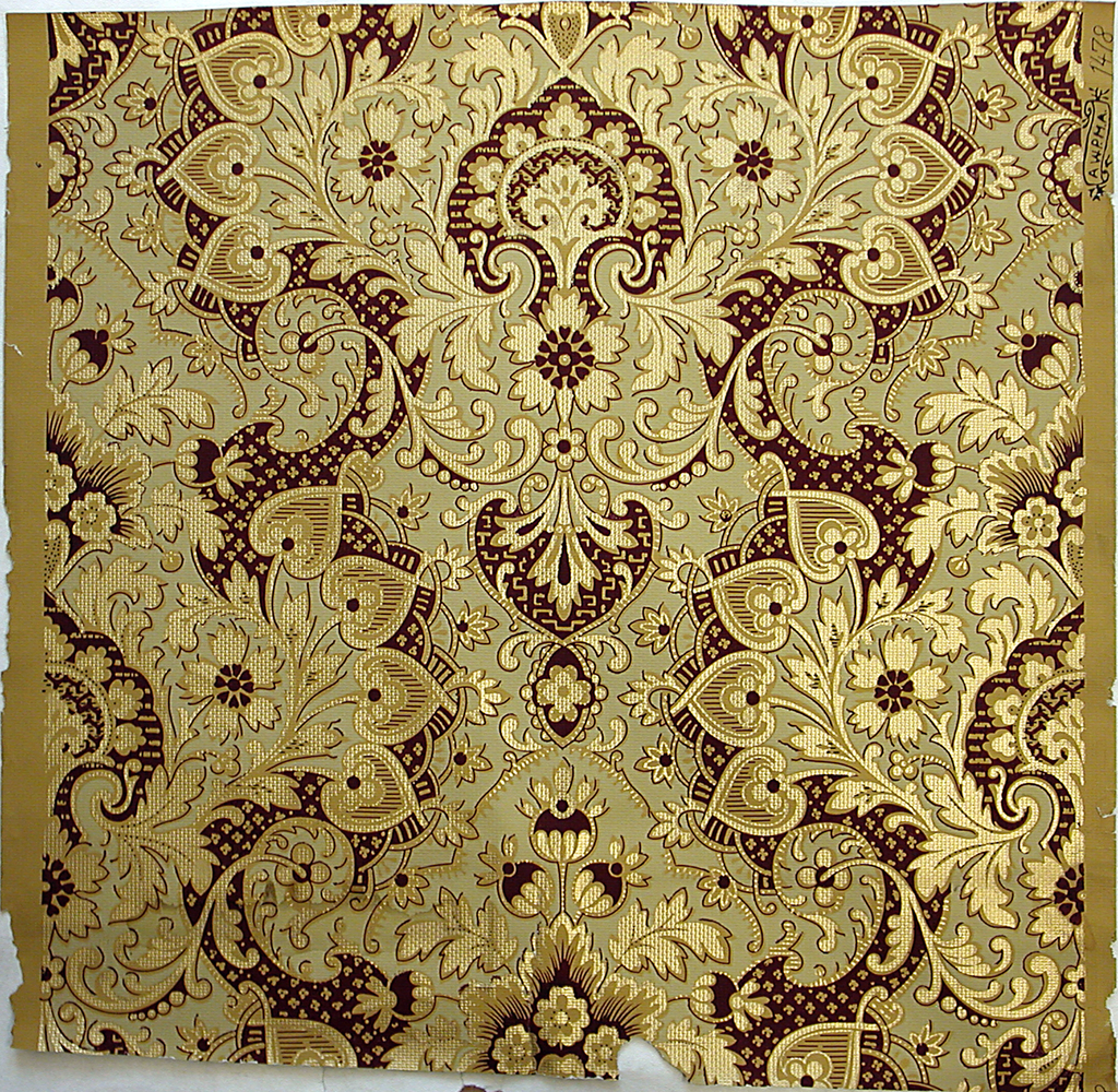 Aesthetic style design. Large-scale stylized floral medallion, printed in metallic gold and burgundy on a yellow ocher ground.