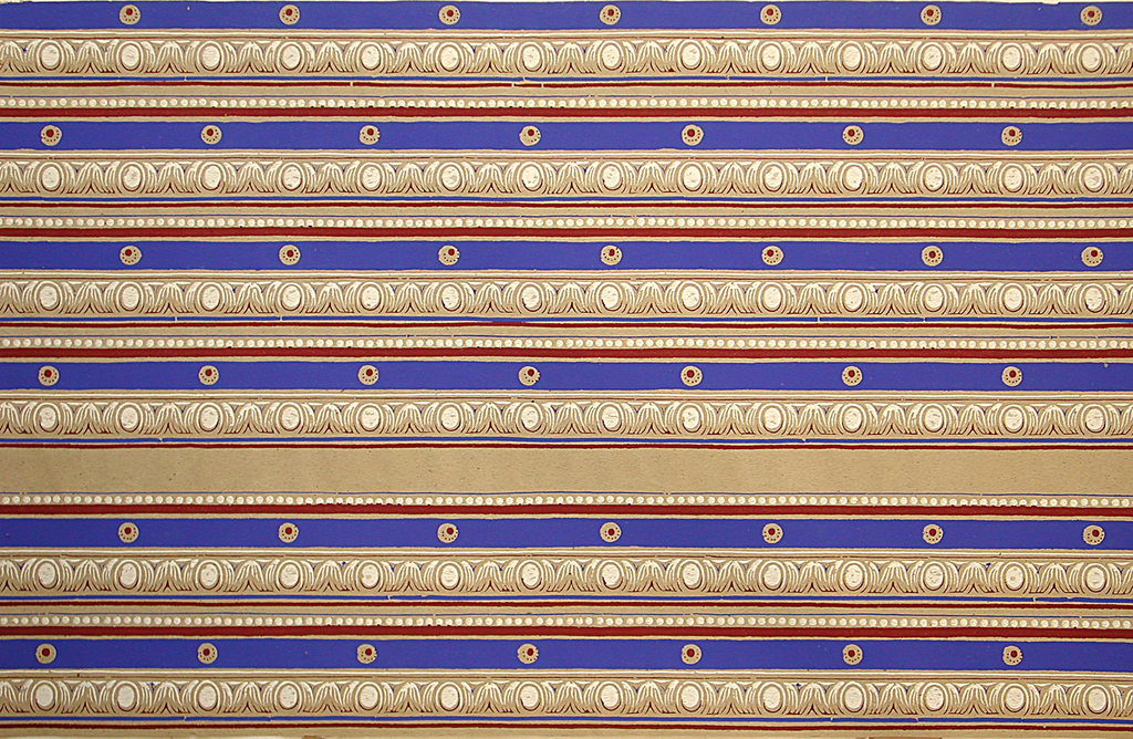 Narrow border with egg and leaf pattern. A blue band runs below, enclosing voided circle with red pin dots. Below this, a solid red band, followed by white beading. Printed on ungrounded tan paper.  H#143