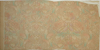 "Symmetrical design inspired from damask pattern. Bouquets of roses in alternating rows. Acanthus leaves encircle them. Entire paper is embossed to simulate a coarse weave such as monk's cloth. Printed on margin: ""U.S.A. 3780, trim."" Printed in soft pastel colors on deep cream background which simulates stipple work."