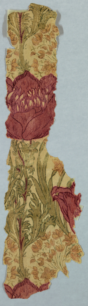 """Large stylized poppy and clusters of small flowers form the drop repeat motif. Finished with a wash which makes it a """"wash print"""" paper. This was the top one of six layers of wallpapers."""