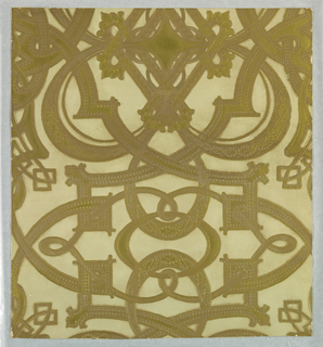 "Imitation leather. A geometric design on a large scale of interlacing circular bands. The bands in turn are covered with small designs as though studded with nail heads. All of design is embossed and finished in brass-colored gilt. Field is plain ivory. Entire surface is antiqued by hand. Printed from wood blocks in oil paints. On reverse side is printed: ""No 8066 2"". Same design as 1944-79-19."