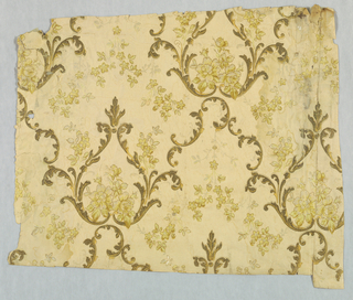 Matcing sidewall and celing paper. Scrolling foliate medallions with inset floral bouquet. Additional foliate scrolls form arch connecting medallions, with pendant floral sprig beneath arch. Ceiling paper has foliate medallions forming quatrefoil motifs, with interlaced vining floral. Printed in metallic gold scrollwork, flowers in shades of yellow, on off-white ground.