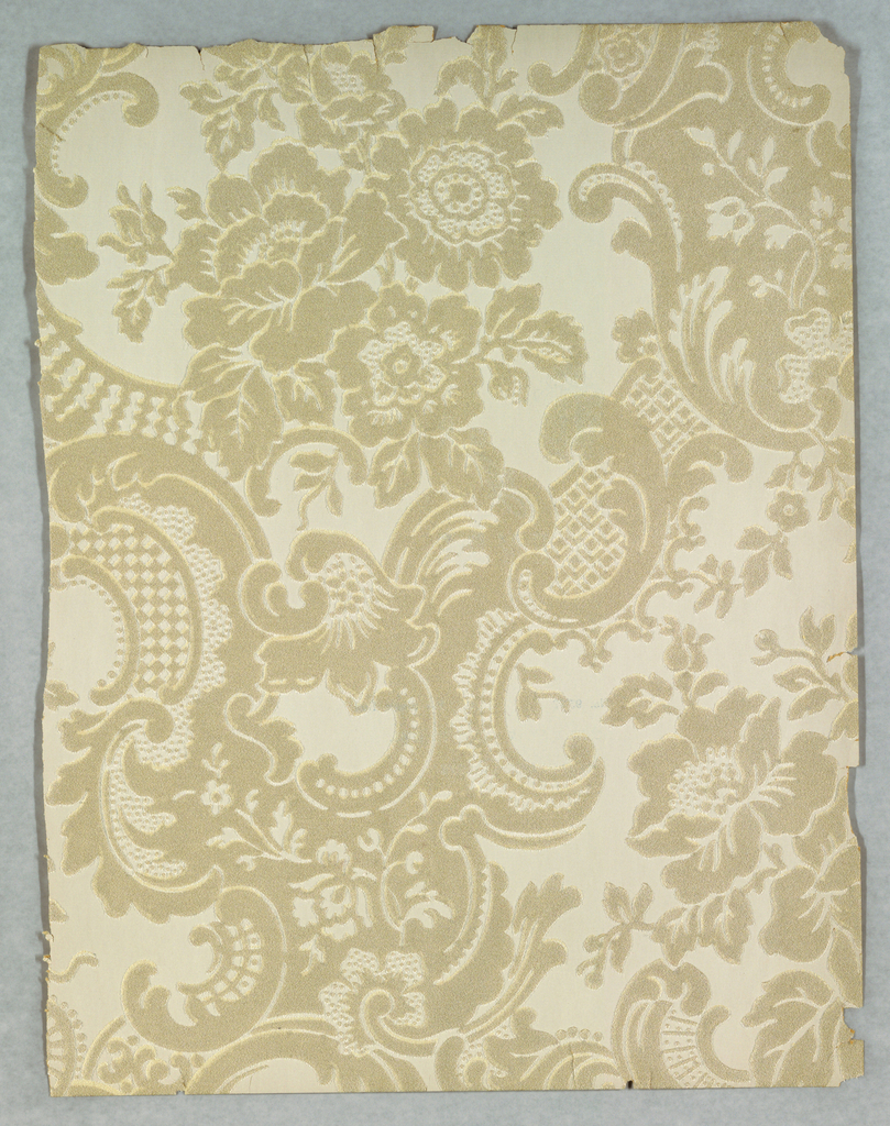 Rococo-style design with large scrolls and floral bouquets. Printed in beige or taupe on white ground.